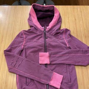 Pink Lululemon hoodie. Size 8 with cute detailing.